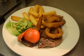 8oz beef steak cooked to your liking served with grill garni, battered onion rings, salad leaves and chunky chips