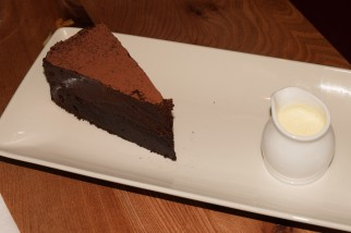 Marquise au chocolat – a rich chocolate torte topped with a layer of chocolate mousse, served with cream