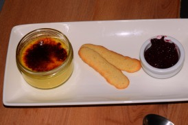 Vanilla crème brûlée with fruit compote and langue de chat biscuits